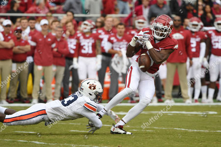 Mike Woods, Roger McCreary. Arkansas receiver Mike Woods cannot hold onto the ball as Auburn defender Roger McCreary defends the pass during the first half of an NCAA college football game, in Fayetteville, Ark