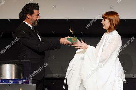 Najwa Nimri (R) receives the 'Espigas de Honor' (lit. Spike of Honor) Award from Spanish filmmaker Julio Medem (L) during the 64th Valladolid International Film Festival (Seminci), in Valladolid, Spain, 22 October 2019. The Seminci Film Festival runs from 19 to 26 October 2019.