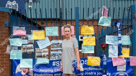 Stock Photo of Local resident Helen Richardson views messages outside Bury Football Club.