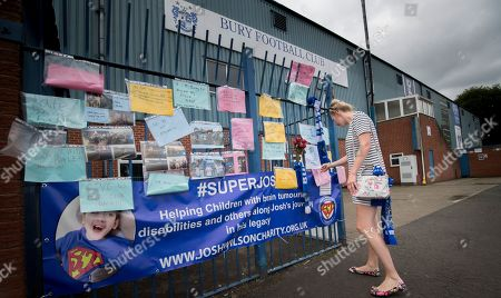 Stock Image of Local resident Helen Richardson views messages outside Bury Football Club.