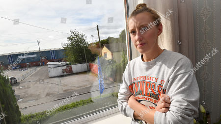 Local resident Helen Richardson poses in her home opposite Bury Football Club.