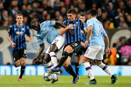 Manchester City defender Benjamin Mendy (22) and Atalanta midfielder Ruslan Malynovskyy (18) challenge for the ball  during the Champions League match between Manchester City and Atalanta at the Etihad Stadium, Manchester
