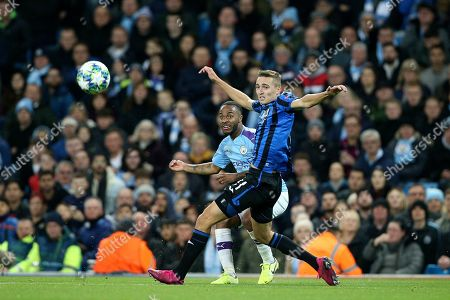 Manchester City midfielder Raheem Sterling (7) gets the cross in past Atalanta midfielder Remo Freuler (11) during the Champions League match between Manchester City and Atalanta at the Etihad Stadium, Manchester