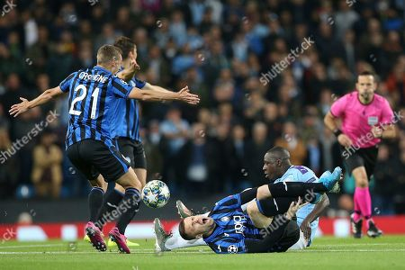 Manchester City defender Benjamin Mendy (22) leaves Atalanta forward Josip Ilicic (72) in pain after his tackle. Manchester City defender Benjamin Mendy (22) gets a yellow card for the challenge. during the Champions League match between Manchester City and Atalanta at the Etihad Stadium, Manchester