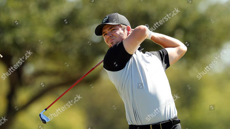 Stock Picture of Charlotte's Mark Boucher tees off on the 15th hole during an NCAA golf tournament on in Dallas