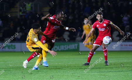 Corey Whiteley of Newport County and Bez Lubala of Crawley Town compete for the ball