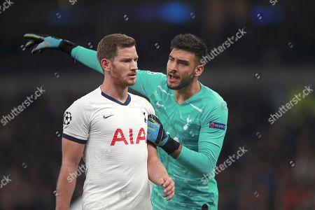 Tottenham's goalkeeper Paulo Gazzaniga, right, argues with Tottenham's Jan Vertonghen during the Champions League, group B, soccer match between Tottenham and Red Star Belgrade, at the Tottenham Hotspur stadium in London