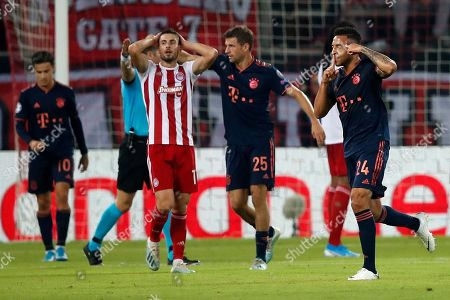 Bayern's Corentin Tolisso, right, celebrates after scoring his side's third goal during the Champions League group B soccer match between Olympiakos and Bayern Munich at the Georgios Karaiskakis stadium, in Piraeus port, near Athens