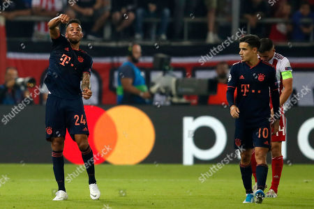 Bayern's Corentin Tolisso, left, celebrates besides team mate Coutinho after scoring his side's third goal during the Champions League group B soccer match between Olympiakos and Bayern Munich at the Georgios Karaiskakis stadium, in Piraeus port, near Athens