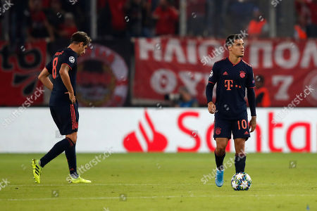 Bayern's Javi Martinez, left, and Bayern's Philippe Coutinho react after Olympiakos' Youssef El-Arabi scored his side's opening goal during the Champions League group B soccer match between Olympiakos and Bayern Munich at the Georgios Karaiskakis stadium, in Piraeus port, near Athens