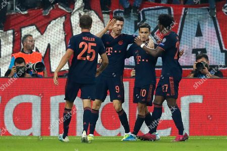 Bayern's Robert Lewandowski, second left, celebrates with team mates Bayern's Philippe Coutinho, second right, Bayern's Thomas Muller, left, and Bayern's David Alaba after scoring his side's second goal during the Champions League group B soccer match between Olympiakos and Bayern Munich at the Georgios Karaiskakis stadium, in Piraeus port, near Athens