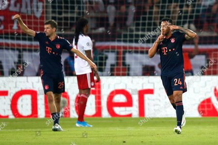 Bayern's Corentin Tolisso celebrates after scoring his side's third goal during the Champions League group B soccer match between Olympiakos and Bayern Munich at the Georgios Karaiskakis stadium, in Piraeus port, near Athens