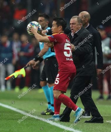 Galatasaray's head coach Fatih Terim (R) and Yuto Nagatomo (L) reacts during the UEFA Champions League group A match between Galatasaray and Real Madrid in Istanbul, Turkey 22 October 2019.