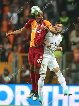 Stock Photo of Real Madrid's Luka Jovic (R) in action Galatasaray's Steven Nzonzi (L) at the UEFA Champions League group A match between Galatasaray and Real Madrid in Istanbul, Turkey 22 October 2019.