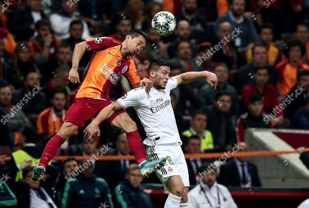 Real Madrid's Luka Jovic (R) in action against Galatasaray's Yuto Nagatomo (L) the UEFA Champions League group A match between Galatasaray and Real Madrid in Istanbul, Turkey, 22 October 2019.