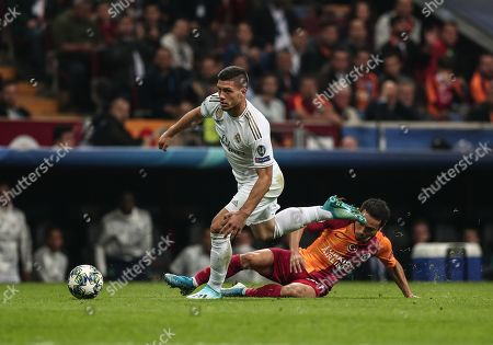 Real Madrid's Luka Jovic (L) in action against Galatasaray's Yuto Nagatomo (R) during the UEFA Champions League group A match between Galatasaray and Real Madrid in Istanbul, Turkey, 22 October 2019.
