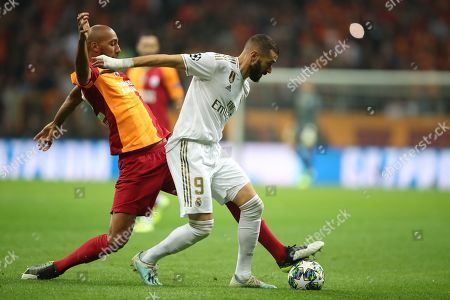 Real Madrid's Karim Benzema (R) in action against Galatasaray's Steven Nzonzi (L) at UEFA Champions League group A match between Galatasaray and Real Madrid in Istanbul, Turkey 22 October 2019.
