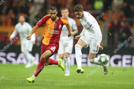 Real Madrid's Federico Valverde (R) in action against Galatasaray's Younes Belhanda (L) at UEFA Champions League group A match between Galatasaray and Real Madrid in Istanbul, Turkey 22 October 2019.