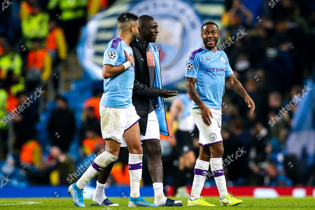 Raheem Sterling of Manchester City speaks to Benjamin Mendy of Manchester City and Riyad Mahrez of Manchester City at full time after scoring a hat-trick against Atalanta