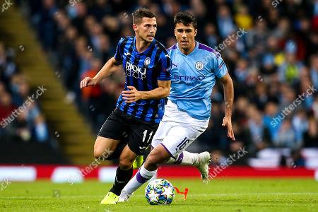 Remo Freuler of Atalanta takes on Rodri of Manchester City