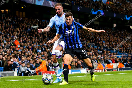 Remo Freuler of Atalanta takes on Kyle Walker of Manchester City