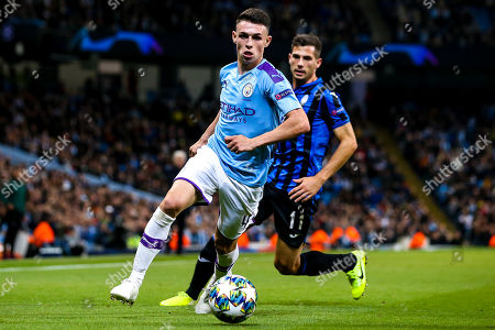 Phil Foden of Manchester City goes past Remo Freuler of Atalanta