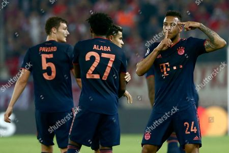 Bayern's Corentin Tolisso, right, celebrates his goal during the Champions League group B soccer match between Olympiakos and Bayern Munich at the Georgios Karaiskakis stadium in Piraeus port, near Athens