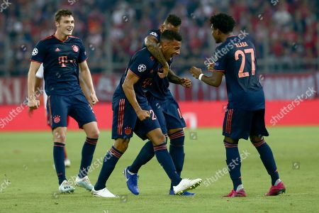 Bayern's Corentin Tolisso, centre, celebrates his goal during the Champions League group B soccer match between Olympiakos and Bayern Munich at the Georgios Karaiskakis stadium in Piraeus port, near Athens