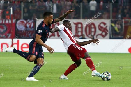 Olympiacos' Mohamed Camara (R) in action against Bayern's Corentin Tolisso (L) during the UEFA Champions League group B soccer match between Olympiacos F.C. and F.C.Bayern Munich at Karaiskaki stadium in Piraeus, Greece, 22 October 2019.