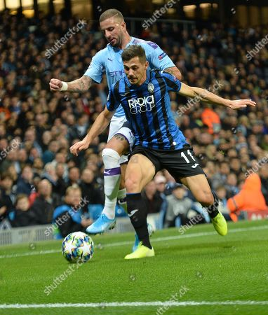 Kyle Walker (L) of Manchester City in action against Remo Freuler of Atalanta during the UEFA Champions League Group C match between Manchester City and Atalanta in Manchester, Britain, 22 October 2019.
