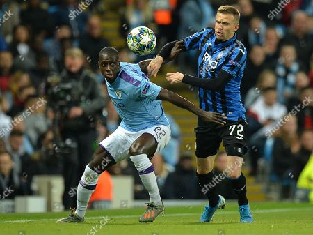 Stock Picture of Benjamin Mendy (L) of Manchester City in action against Josip Ilicic of Atalanta during the UEFA Champions League Group C match between Manchester City and Atalanta in Manchester, Britain, 22 October 2019.