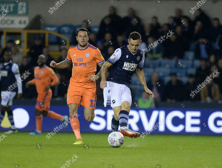 Shaun Williams clears for Millwall watched by Cardiff's Lee Tomlin.