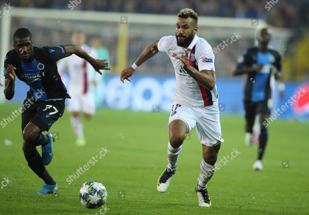 PSG's Eric Maxim Choupo-Moting, center, goes after the ball against Brugge's Clinton Mata, left, during a Champions League Group A soccer match between Club Brugge and Paris Saint Germain at the Jan Breydel stadium in Bruges, Belgium