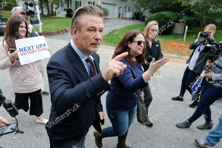 Alec Baldwin, Amanda Pohl. Actor Alec Baldwin, left, walks with Amanda Pohl, candidate for Virginia Senate District 11 in her neighborhood in Midlothian, Va., . Baldwin campaigned for several candidates around the state