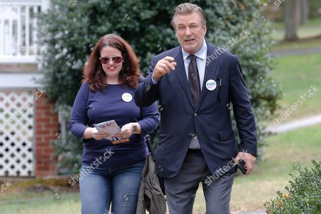 Alec Baldwin, Amanda Pohl. Actor Alec Baldwin, right walks with Amanda Pohl, candidate for Virginia Senate District 11 in her neighborhood in Midlothian, Va., . Baldwin campaigned for several candidates around the state