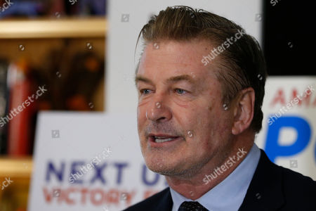 Actor Alec Baldwin, speaks to supporters of Amanda Pohl, candidate for Virginia Senate District 11 in her home in Midlothian, Va., . Baldwin campaigned for several candidates around the state