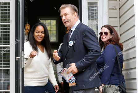 Stock Photo of Alec Baldwin, Amanda Pohl, Kristin Goodlett. Actor Alec Baldwin, center, points out a throng of media as he talks to Kristin Goodlett as he walks with Amanda Pohl, candidate for Virginia Senate District 11 in her neighborhood in Midlothian, Va., . Baldwin campaigned for several candidates around the state