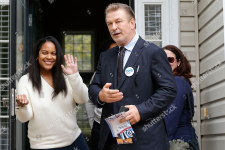 Stock Picture of Alec Baldwin, Amanda Pohl, Kristin Goodlett. Actor Alec Baldwin, center, points out a throng of media as he talks to Kristin Goodlett as he walks with Amanda Pohl, candidate for Virginia Senate District 11 in her neighborhood in Midlothian, Va., . Baldwin campaigned for several candidates around the state