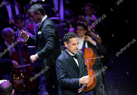 Stock Picture of Peruvian operatic tenor Juan Diego Florez performs during his concert at the Erkel Theatre in Budapest, Hungary, 22 October 2019. Florez performed with the Hungarian State Opera Orchestra, conducted by Jader Bignamini of Italy.