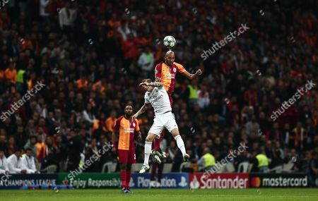 Real Madrid's Toni Kroos (L) in action against Galatasaray's Steven Nzonzi (R) at UEFA Champions League group A match between Galatasaray and Real Madrid in Istanbul, Turkey 22 October 2019.