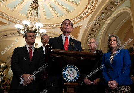 United States Senator Todd Young (Republican of Indiana), United States Senator John Thune (Republican of South Dakota), United States Senator John Barrasso (Republican of Wyoming), United States Senate Majority Leader Mitch McConnell (Republican of Kentucky), and United States Senator Joni Ernst (Republican of Iowa) hold a press conference following Senate Policy Luncheons on Capitol Hill.
