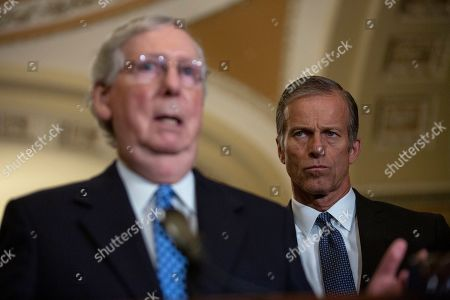 United States Senator John Thune (Republican of South Dakota) listens to United States Senate Majority Leader Mitch McConnell (Republican of Kentucky) speak during the Senate Policy Luncheon Press Conference on Capitol Hill.