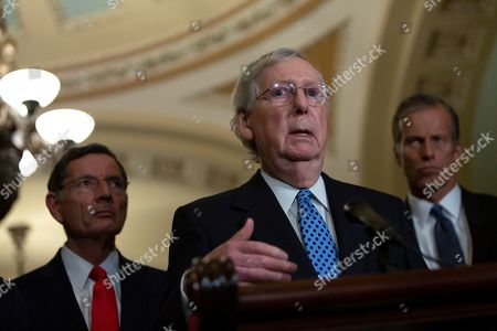United States Senate Majority Leader Mitch McConnell (Republican of Kentucky), joined by United States Senator John Barrasso (Republican of Wyoming) and United States Senator John Thune (Republican of South Dakota), speaks during the Senate Policy Luncheon Press Conference on Capitol Hill.