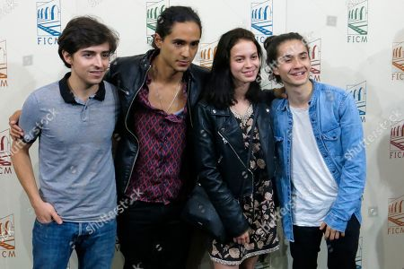 """Actors Diego Lavalle, from left, Joshua Okamoto, Ana Valeria Becerril and Yojath Okamoto, of the Mexican film, """"Muerte al verano"""" pose for photos during a press conference at the Morelia Film Festival in Morelia, México"""