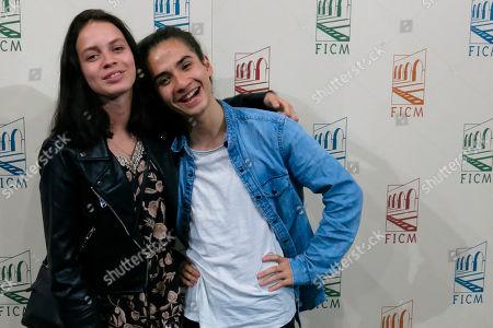 "Actors Ana Valeria Becerril and Yojath Okamoto, of the Mexican film, ""Muerte al verano"" pose for photos during a press conference at the Morelia Film Festival in Morelia, México"
