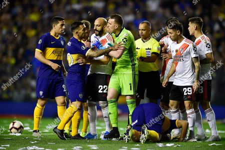 Goalkeeper Franco Armani of River Plate and Carlos Tevez of Boca Juniors, second from left, argue during a Copa Libertadores semifinal second leg soccer match at La Bombonera stadium in Buenos Aires, Argentina