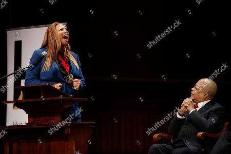 Queen Latifah, Henry Louis Gates Jr. Music artist and actress Queen Latifah shouts during her speech as Professor Henry Louis Gates, Jr. listens after she received the W.E.B. Dubois Medal for her contributions to black history and culture during ceremonies at Harvard University, in Cambridge, Mass