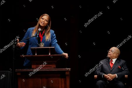 Music artist and actress Queen Latifah speaks as Professor Henry Louis Gates, Jr. listens after she received the W.E.B. Dubois Medal for her contributions to black history and culture during ceremonies at Harvard University, in Cambridge, Mass