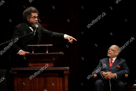 Harvard Professor Cornel West, left, speaks as Professor Henry Louis Gates, Jr. listens during ceremonies on campus where W.E.B. Dubois Medals were awarded for contributions to black history and culture, in Cambridge, Mass