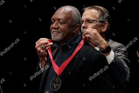 Stock Image of Artist Kerry James Marshall receives the W.E.B. Dubois Medal from Glenn Hutchins for his contributions to black history and culture during ceremonies at Harvard University, in Cambridge, Mass
